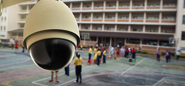 Does giving a parent a copy of a surveillance video showing a school hazing incident involving multiple students violate FERPA?